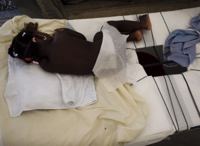 A young cholera patient awaits treatment at a MSF facility in Port-au-Prince.