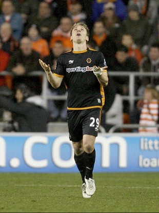 Kevin Doyle celebrates scoring for Wolves against Blackpool on Saturday.