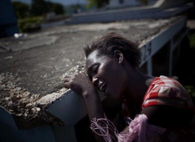 A relative of a 12-year-old cholera victim in Haiti mourns at her graveside