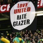 United fans unfurled a new banner during the Champions League game against AC Milan. Fans were working with leading financiers - the so-called Red Knights - to form a takeover bid to oust the owning Glazers family. It ultimately came to nothing. <span class=