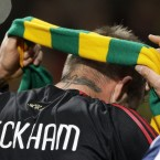In the same game, the returning David Beckham draped himself in the green and gold as he left the Old Trafford pitch for the last time - to an ovation from the Stretford End.