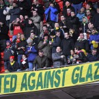 Old Trafford fans took to the green and yellow of Newton Heath in protest at the Glazer family takeover. <span class=