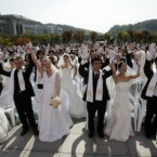 Attention all getting a bit much? Kate and William could consider dodging the cameras in a mass wedding like this one in South Korea.