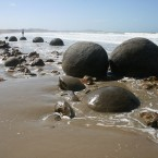 A beach on the east coast of New Zealand's south island is home to strange geological formations. Huge spherical stones line the shore, having fallen out of the cliffs as coastal erosion eats into the rock. Some of the rounded rocks have cracked open, revealing honeycomb-like formations inside. (Image: elisfanclub via Creative Commons)