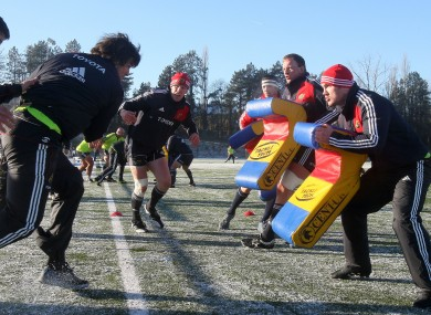 Paul O'Connell looks on as Donncha O'Callaghan into the tackle bags at Garryowen RFC in Dooradoyle, Co Limerick today.
