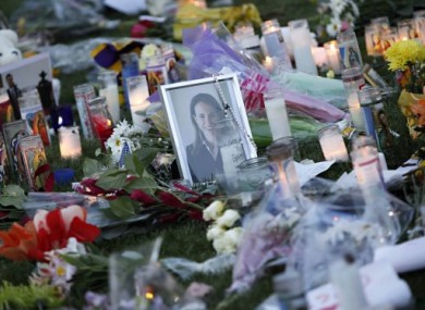 Flowers, candles and a photo of Gabrielle Giffords in Tucson, Arizona, in memory of the victims of Saturday's shooting.