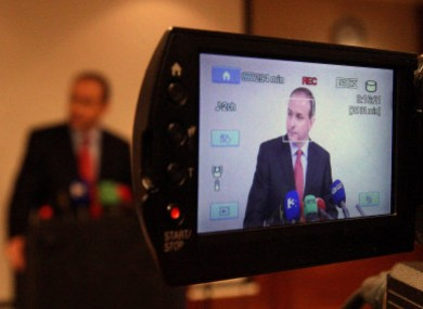 Micheál Martin speaks to the media at the Burlington Hotel last night, announcing his intention to vote against Brian Cowen in Tuesday's motion of confidence.
