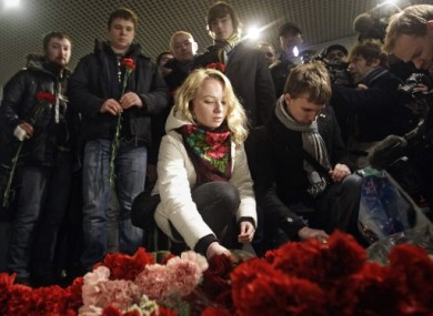 People lay flowers at the scene of last week's explosion at Domodedovo airport.