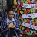Students from a school near the hospital where former South African President Nelson Mandela, fondly known as 'Madiba', was undergoing medical tests this week. He was released from hospital today.