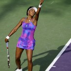 Venus serves to Shahar Peer of Israel during day six of the Sony Ericsson Open at the Crandon Park Tennis Center in 2009.