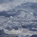 An aerial view shows a downtown area of Takaharumachi, Miyazaki Prefecture covered with ash gushing from the erupting Shinmoedake, 31 January, 2011. (The Yomiuri Shimbun via AP Images)