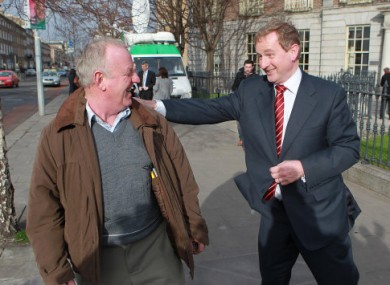 Enda Kenny greets a member of the public after launching his party's election campaign last week.