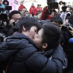 A Chinese lesbian couple kisses in front of journalists. Beijing's gay and lesbian community celebrated Valentine's Day by calling for greater gay rights in China on Monday in Beijing. (AP Photo/Andy Wong)