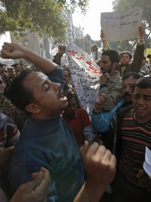 Workers demanding higher wages protest outside a national TV building in Cairo today.