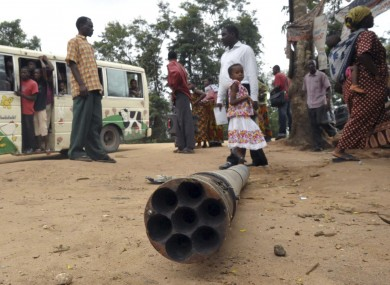 People walk past munitions left on the streets near the military depot