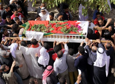 Bahraini mourners march in a funeral procession on Friday