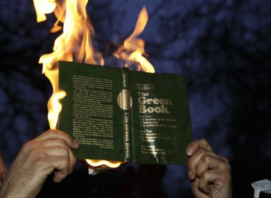 Libyan protesters at the US Embassy burnt copies of Colonel Muammar Gaddafi's Green Book - the leader's 1975 political manifesto.