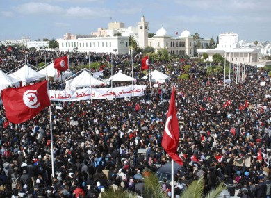 Tunisian protesters gathered on Friday to demand the prime minister's resignation