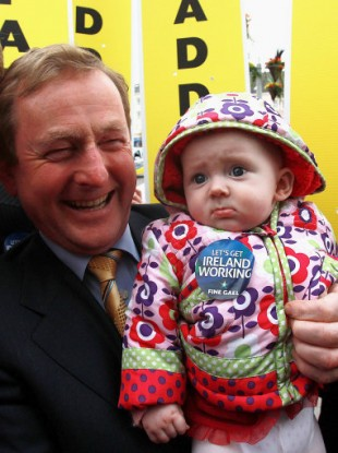 Enda Kenny has promised to get Ireland working and baby May Hennelly may be worried she won't be exempt...