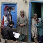 Census workers take details of a Kashmiri family on the outskirts of Srinagar, India - the country has begun a mammoth effort to document every citizen in three weeks.<span class=