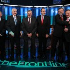 Frontline host Pat Kenny covers an awkward moment as Gerry Adams and Enda Kenny cosy up in advance of the five-way leaders' debate at RTE. Pic: PA Images/Julien Behal.