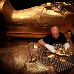 A curator examines one of the replica sarcophagus at the Tutankhamun: His Tomb and Treasures show which opens at the RDS Dublin next week.<span class=