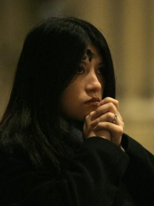 Maria Pantosin prays during Ash Wednesday mass at St. Patrick's Cathedral in New York.
