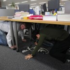 Reporters at the Associated Press Tokyo Bureau take shelter during the earthquake. (AP Photo/Itsuo Inouye)