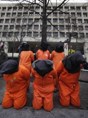 Protestors in faux-Guantanamo detention jumpsuits Washington DC, January 2011.