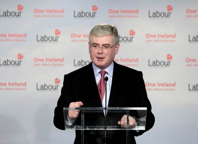 Labour leader Eamon Gilmore has been reminded that his party still has the option of entering opposition, as talks between his team and that of Enda Kenny continue.