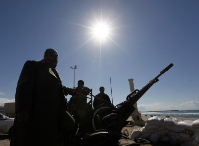 Anti-aircraft machine guns set up by rebels in Benghazi who may soon be aided by a no-fly zone over Libya