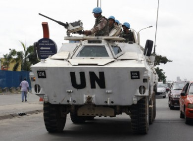 Jordanian UN soldiers driving in Abidjan, Ivory Coast, yesterday.