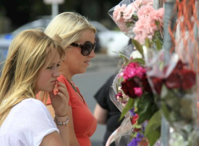 Citizens visit a devastated site to mark last week's earthquake in Christchurch.