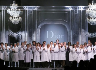 Dior fashion house employees acknowledge applause at the end of the Fall-Winter 2012 ready to wear collection today.
