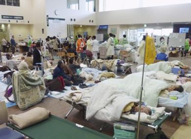 Patients are treated in the lobby of Ishinomaki Red Cross Hospital in Ishinomaki, Miyagi Prefecture,