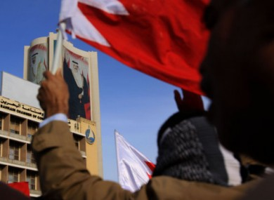 Anti-government protesters march towards the Saudi embassy in Manama, Bahrain, yesterday.