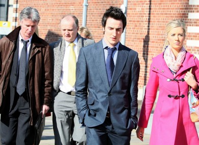 Hazel Stewart's husband David (left), son Andrew (second right) and daughter Lisa, leave Belfast Crown court, after Mrs. Stewart, was jailed for a minimum of 18 years