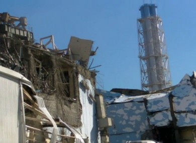 Image released by the Japan Defence Ministry shows damage to Unit 3 reactor, left.