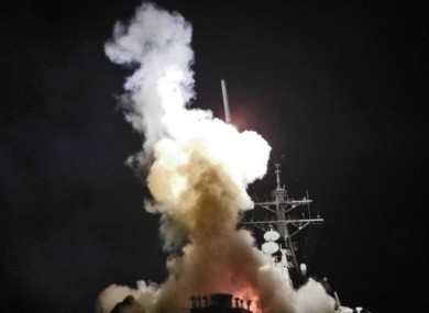 US Navy photo shows a destroyer launching a Tomahawk missile last night.