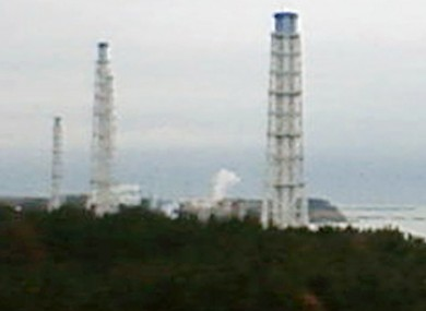 Smoke is seen emerging from one of the damaged reactor buildings at the Fukushima I power plant.