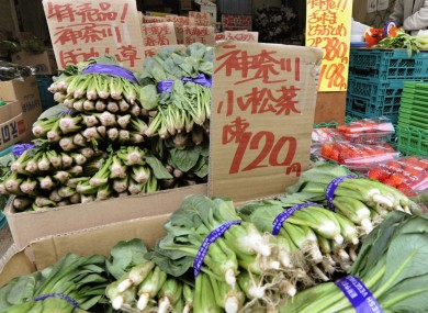 A greengrocer in Tokyo sells spinach from the Kanagawa prefecture - which has not been affected by radioactivity. Most food from the Fukushima prefecture has been taken off the market.