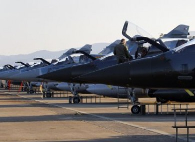 French jet fighters stand ready for a mission to Libya from Corsica yesterday.