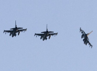 Three Dutch F-16 aircraft prepare for landing at the Decimomannu airbase, in Sardinia, Italy, Thursday, March 24, 2011