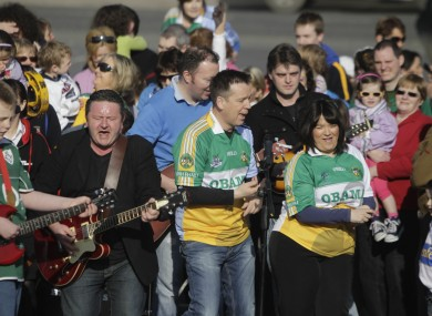 Ger Corrigan (2nd left) and RTÉ presenter Derek Mooney (centre) direct the residents of Moneygall as they shoot the music video for the Corrigan Brothers' new song, 'Welcome Home President Barack Obama', yesterday.