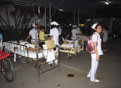 Patients at Chiang Rai hospital are treated on the ground after they were evacuated from a hospital building following an earthquake in Chiang Rai province, northern Thailand Thursday, 24 March
