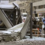 A ruined bus stop was crushed by a fallen wall in Sendai, Miyagi Prefecture, northern Japan. (AP Photo/Kyodo News)