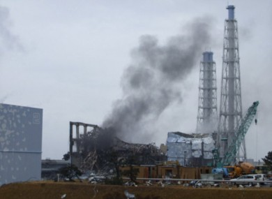 Smoke rises from Unit 3 of the Fukushima plant today and workers were temporarily evacuated from the station