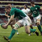 Ireland captain Brian O'Driscoll scores a try but is disallowed for a forward pass<span class=