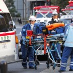 Tokyo Fire Department rescue workers arrive at Kudan Kaikan in Tokyo as local media said its ceiling collapsed on top of people (AP Photo/Itsuo Inouye)