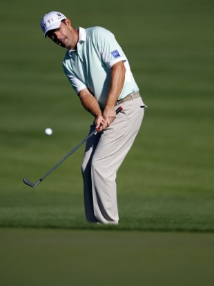 Harrington chips on the 10th hole during the first round of the Transitions Championship, Florida.